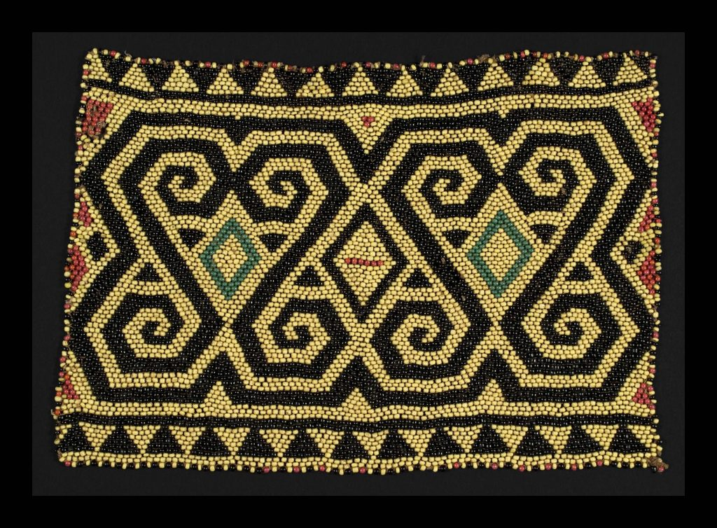 Quantum numbers are related to counting quarks, which is like counting the beads in this woven panel from Borneo.