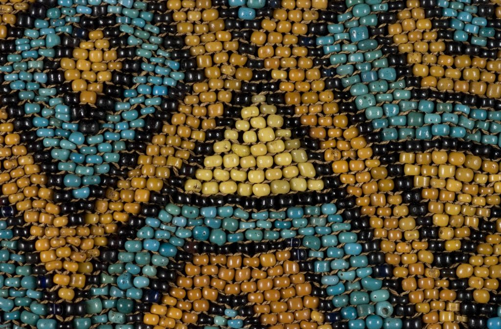 Counting quarks is like counting the beads in this baby carrier panel from Borneo.