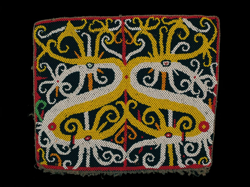 Photon types are distinguished by somatic and phase relationships, somewhat like this beaded pattern from Indonesia.