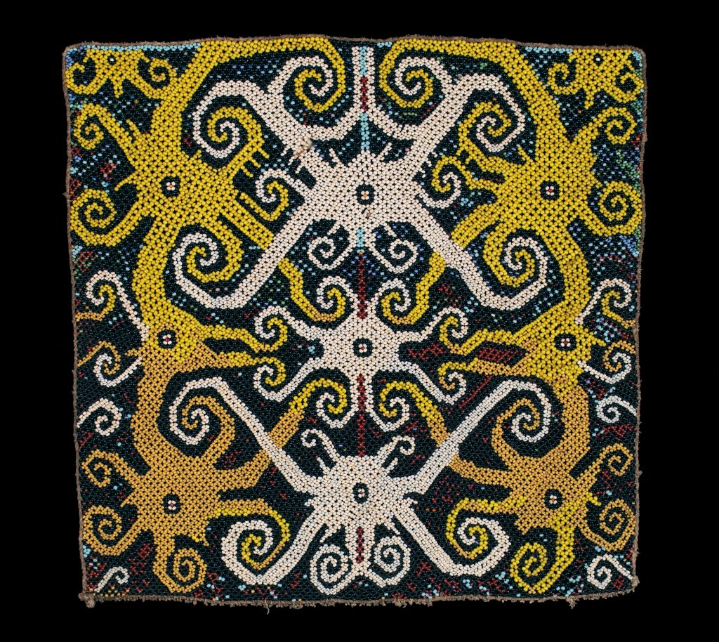 Excited states are a mix of symmetric and asymmetric patterns, like this bead panel from Kalimantan.