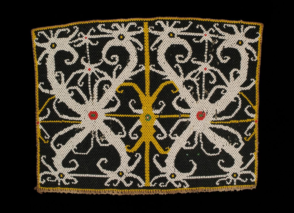 Photons have almost perfect phase anti-symmetry, somewhat like this bead panel from Indonesia.