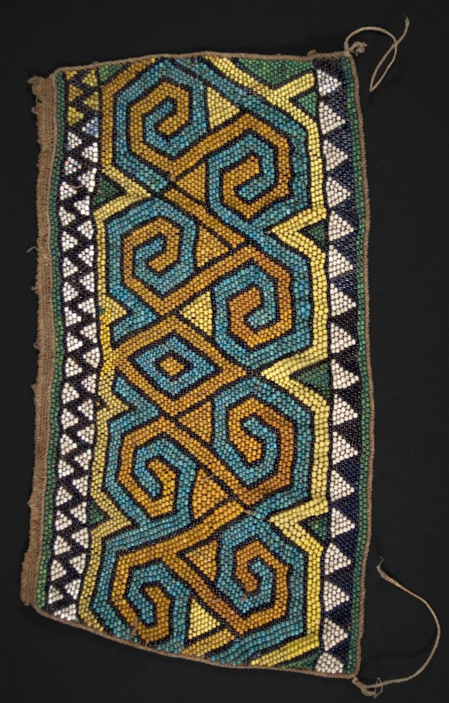 Momentum conservation is like counting the beads in this textile from Kalimantan.