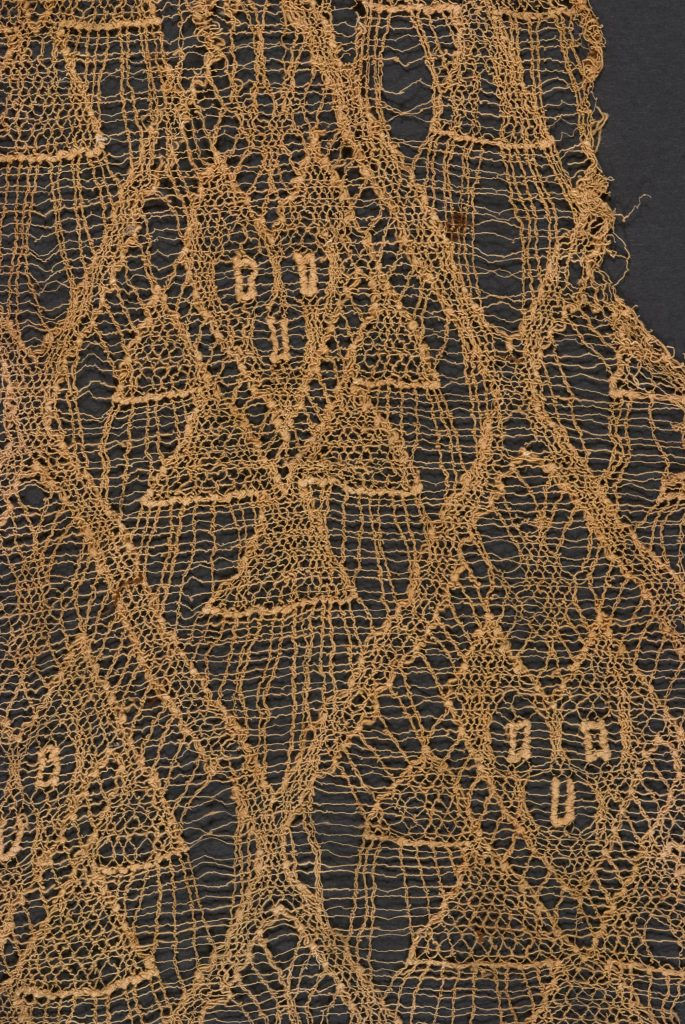 The lifetime of a particle is suggested by this ancient network of threads and spectral figures.