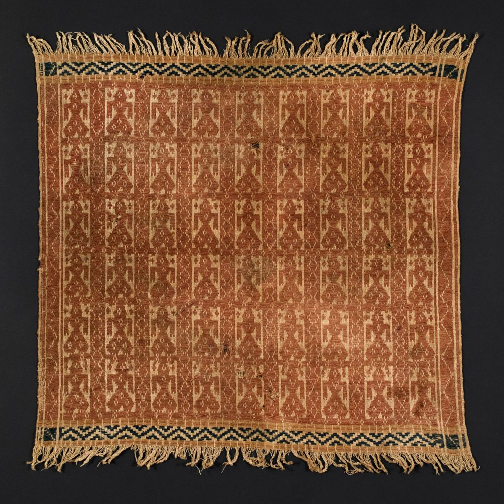 Spatial homogeneity is suggested by the uniform distribution of woven motifs in this Indonesian textile.